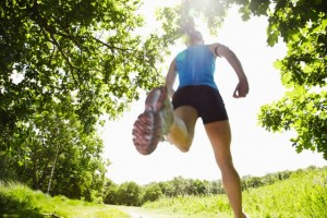 Woman running in forest --- Image by © Moof/cultura/Corbis